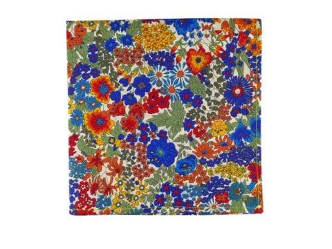 Pochette de veste fleurs multicolores, modèle Aurélio. Bleu outremer, rouge, turquoise, orange, vert d'eau, jaune, écru